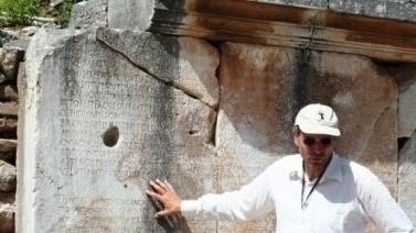 I am explaining bilingual Greco Roman inscriptions on Couretes Boulevard, in Ephesus